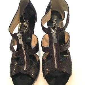 Michael Kors purple snakeskin zip up heels.